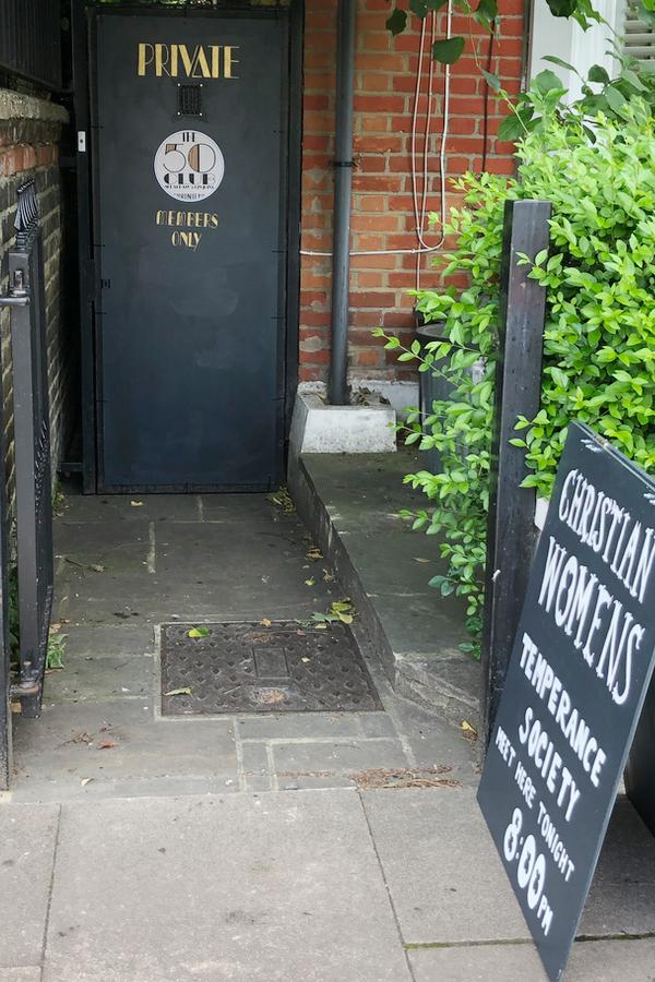 Speakeasy door with peephole
