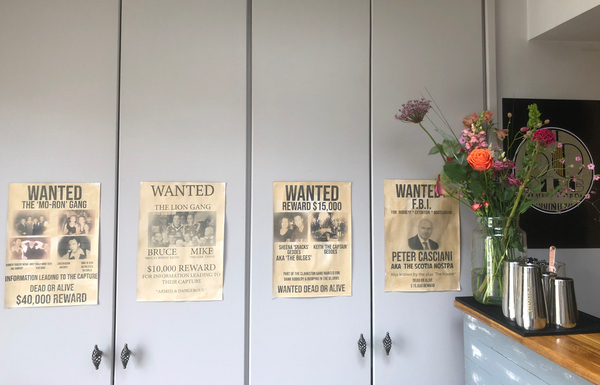 handmade Wanter posters on the wall of speakeasy party