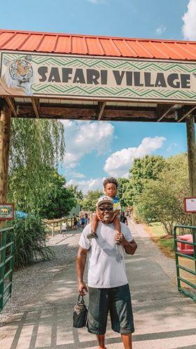 "Father and son entering ""Safari Villiage"" at drive through safari"