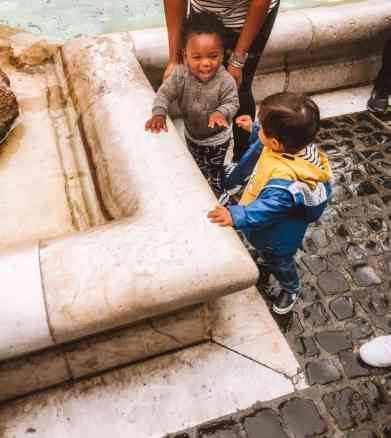 Toddlers at the Trevi Fountain playing.