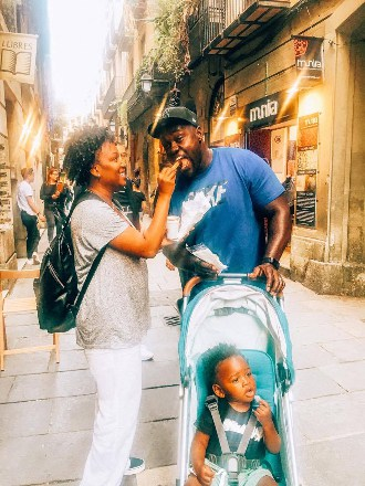 A family eating churros in Barcelona with a toddler.