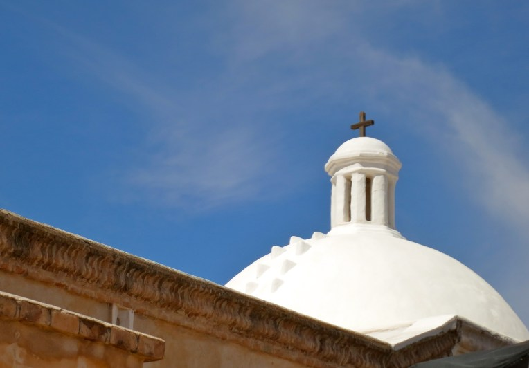 White mission dome against azure sky