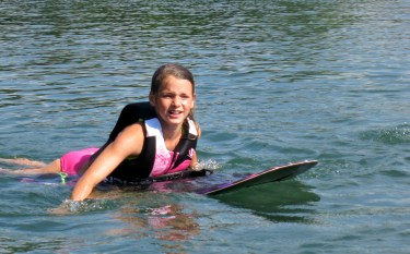 Paige preparing to knee-board with a girlfriend