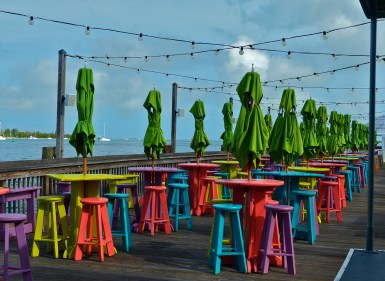 Colorful chairs awaiting their first customers of the day