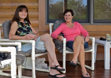 Sis Adele and me enjoying a cocktail together and reminiscing on her porch.