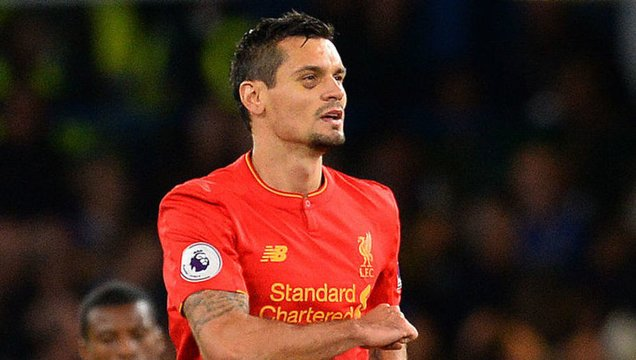 Liverpool's Croatian defender Dejan Lovren celebrates scoring his team's first goal during the English Premier League football match between Chelsea and Liverpool at Stamford Bridge in London on September 16, 2016. / AFP / GLYN KIRK / RESTRICTED TO EDITORIAL USE. No use with unauthorized audio, video, data, fixture lists, club/league logos or 'live' services. Online in-match use limited to 75 images, no video emulation. No use in betting, games or single club/league/player publications.  /         (Photo credit should read GLYN KIRK/AFP/Getty Images)