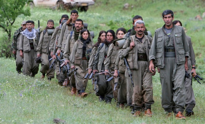 Kurdistan Workers Party (PKK) fighters walk on the way to their new base in northern Iraq