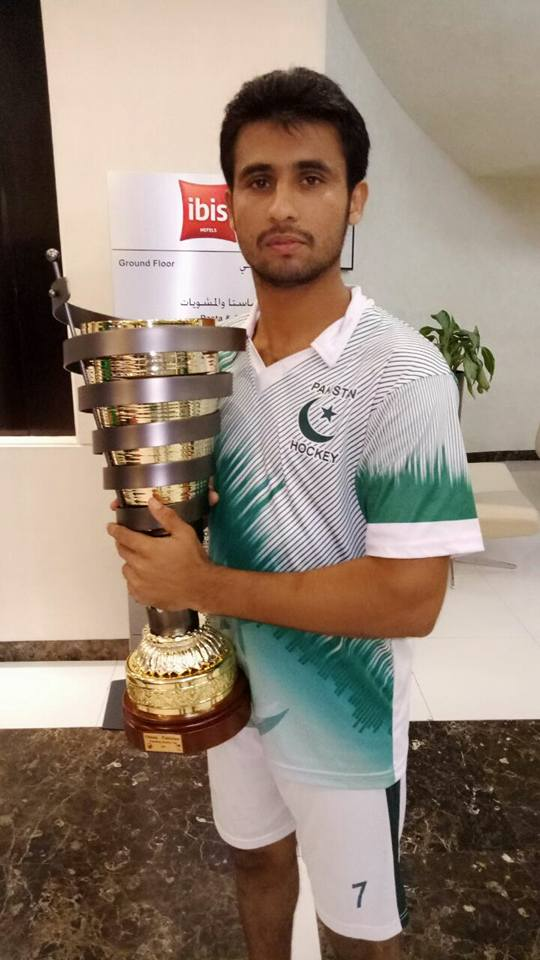 Pakistan Development Squad's captain Shajeeh Ahmed with the Series' Trophy (1)
