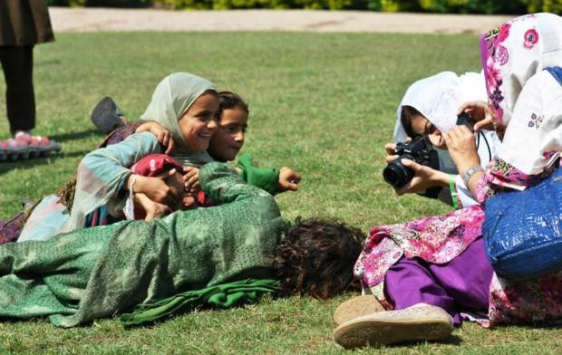 Female Participants taking photographs during the Nat-Geo Photo Camps