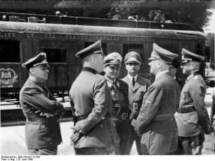 WWII Exterior (Hitler is second from right) (http://ww2today.com/wp-content/uploads/2010/06/Bundesarchiv_Bild_183-M1112-500_Waffenstillstand_von_Compi%C3%A8gne_Hitler_G%C3%B6ring-595x447.jpg)