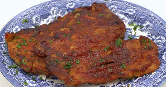 Fresh Tomato Barbecue Sauce on grilled pork steaks