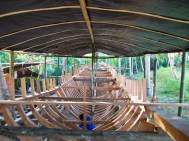 Building a roof over the boat to protect the carpenters from the summer heat.