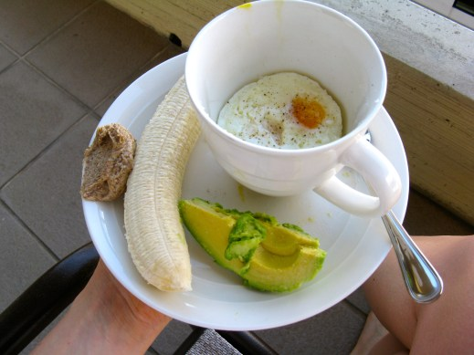 Mmm ... breakfast outside on the lanai: two eggs, avocado, and a banana with fresh ground almond butter.