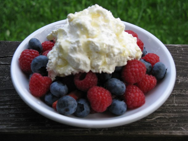 Berries topped with half and half yogurt. This was our 4th of July dessert this past summer.