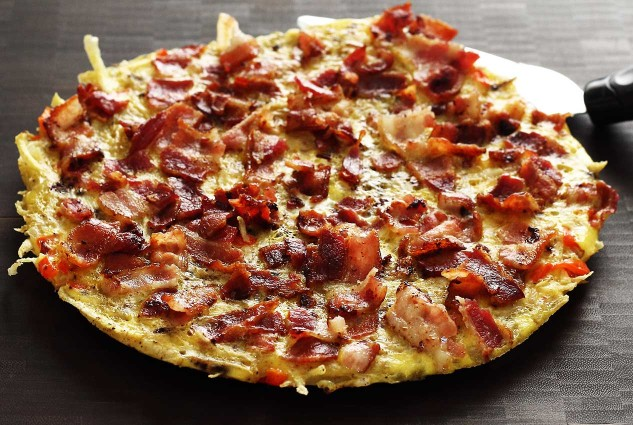 This hash browns recipe is a one-skillet dish. Top with bacon, slide it out, slice and serve. Super easy!