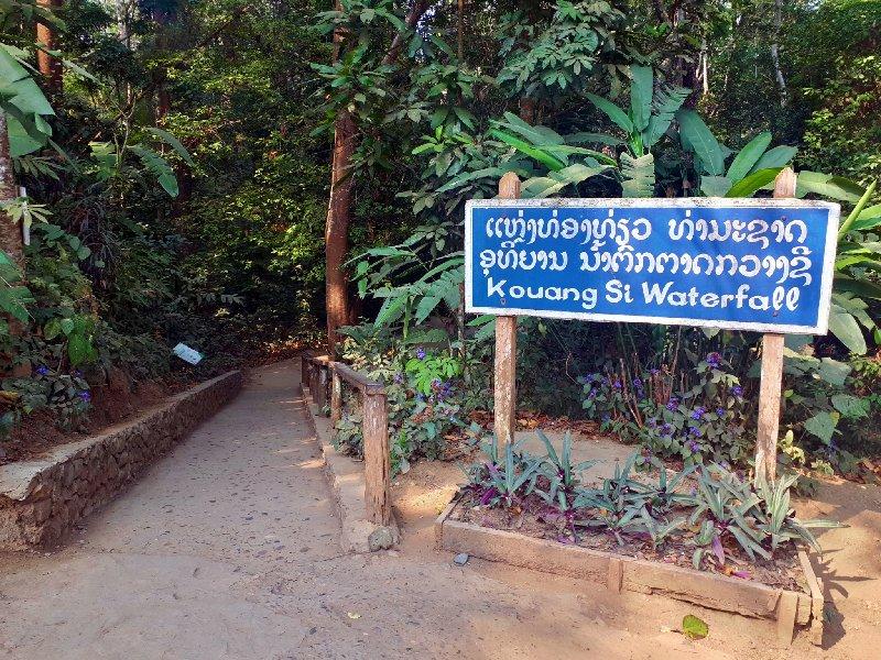 kuang si falls entrance sign