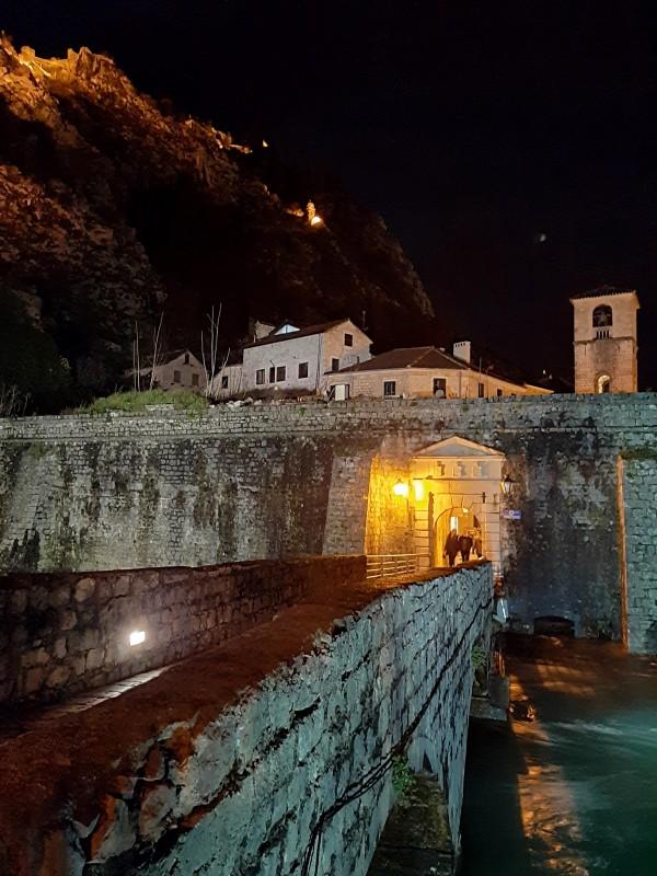 stone bridge kotor night gate wall