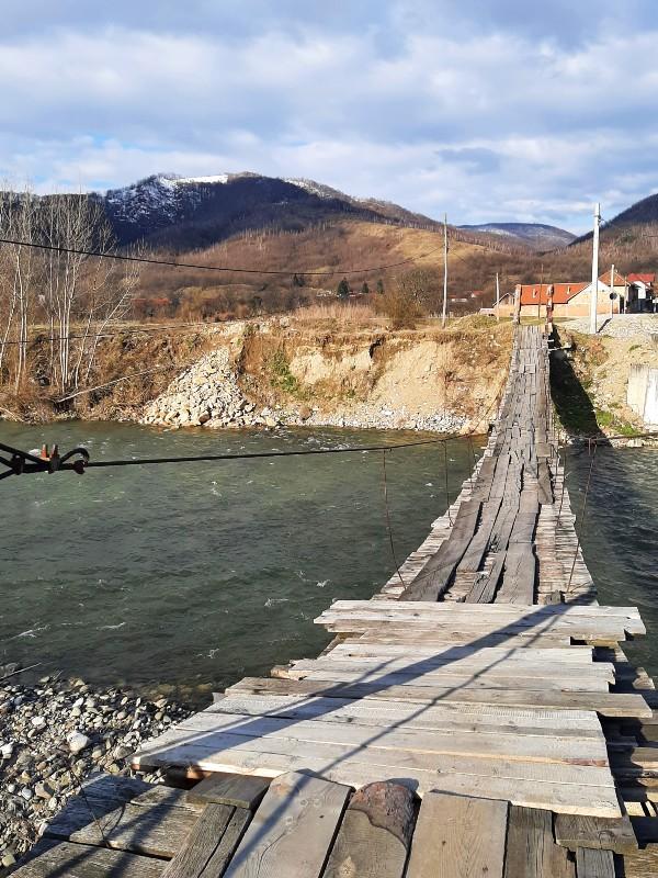 footbridge river mountains romania