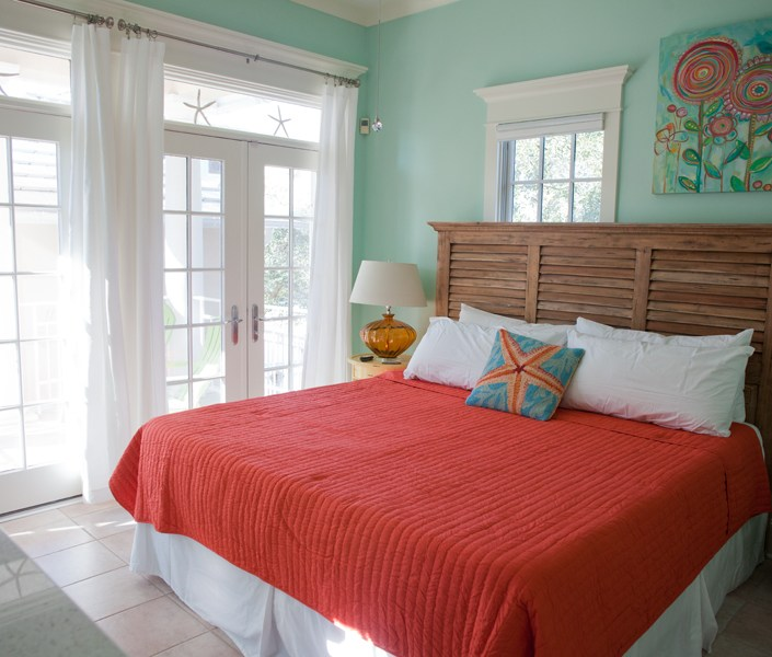Colorful seafoam green and coral bedroom
