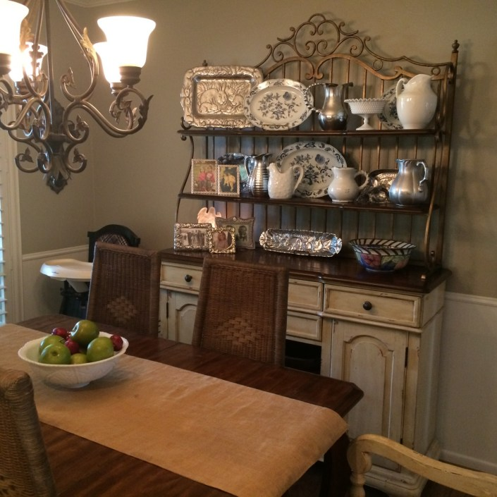 Transitional dining room table and decorative plates