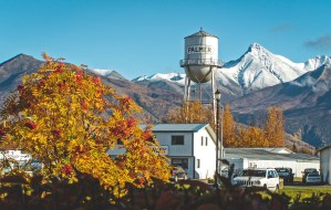 Downtown Palmer Water Tower with fall colors and Matanuska Peak covered in snow