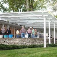 This patio awning is 44' wide x 24' with no center post. The top closes to block heat and rain. It opens to allow hot air to escape or to let light in.