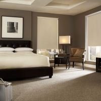 Create a tranquil bedroom with window shades designed to block summer heat and sun glare.