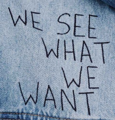 blue denim collared top with we see what we want text overlay