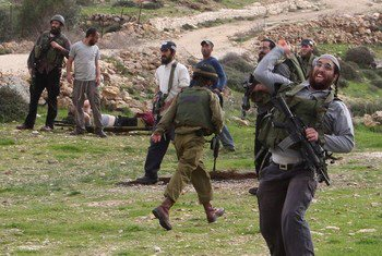 Settler attacks in Madama. Photo by Jaafar Ashtiyeh/AFP/Getty Images 2012