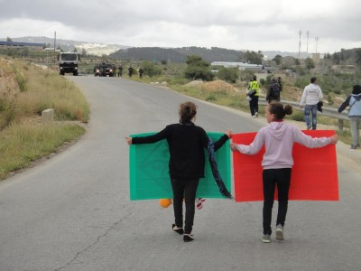 Young protesters walking towards the Israeli military