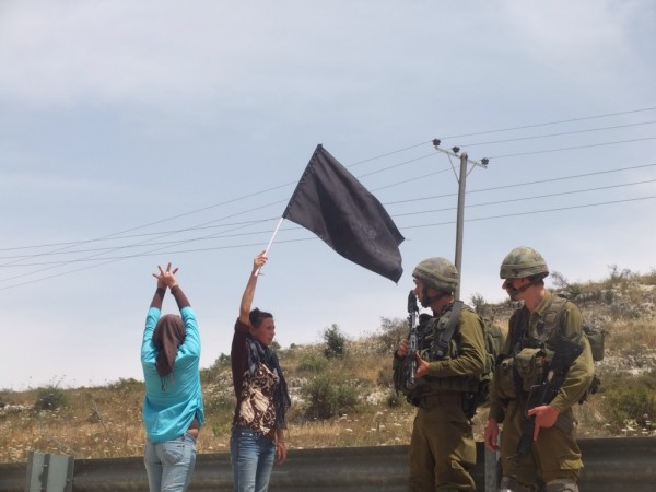 Residents of Nabi Saleh confront soldiers blocking them from reaching their stolen well