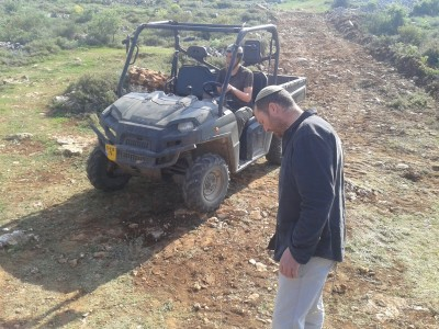 Two of the settlers whom made the attack and the outdoor utility vehicle used to kill the sheep (Aqraba Municipality, March 2013)