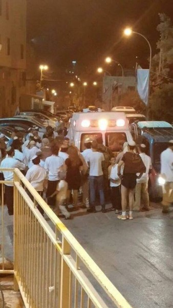 Ambulance carrying dying Palestinian prevented from leaving Shuhada Street by frenzied settlers.