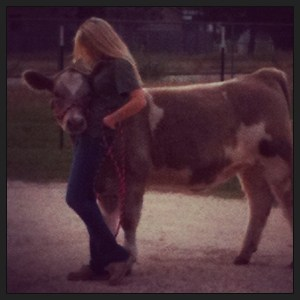 A girl and her cow.