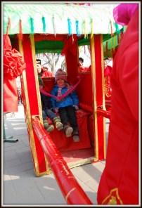 Riding a pallanquin