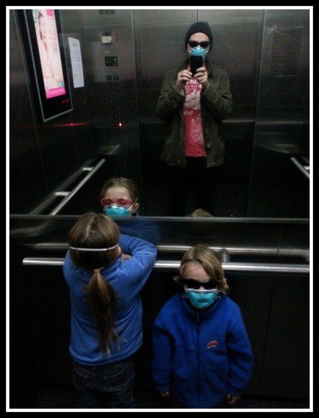 In our elevator, getting ready to go outside