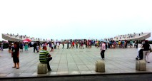 """Xinghai Square looking out to the ocean at the """"open book"""""""