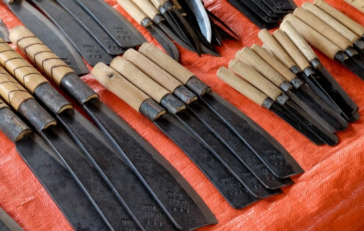 Locally made knives of various sizes are sold at the Mingalar market in Nyuang Shwe.