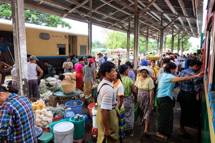 A chaotic market at Dinyangon station in Yangon