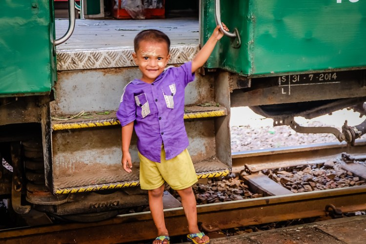 A little boy plays on the train platform at Yangon Central Railway station