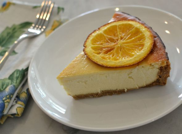 Spiced Rum and Orange Cheesecake with a Sweet Warm Rum Sauce