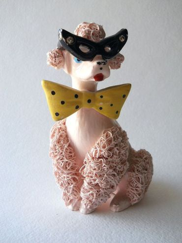 Pink ceramic poodle with glasses and bow tie