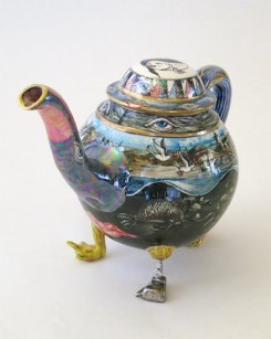 Multicoloured teapot on legs