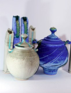 tall and round pots in blue turquoise and grey