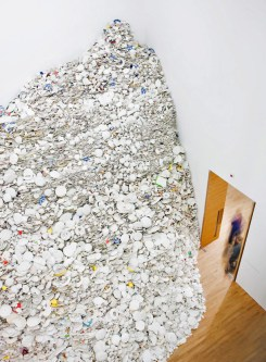 large pile of broken crockery in the corner of a room