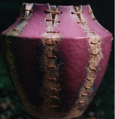 Purple vase with slashes and thread