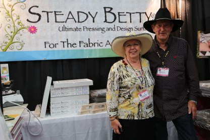 Friends on the Steady Betty stand displaying my flyer for the Southern New Mexico Quilt Festival.