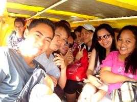 snuggled inside the small yellow mini jeepney cab!