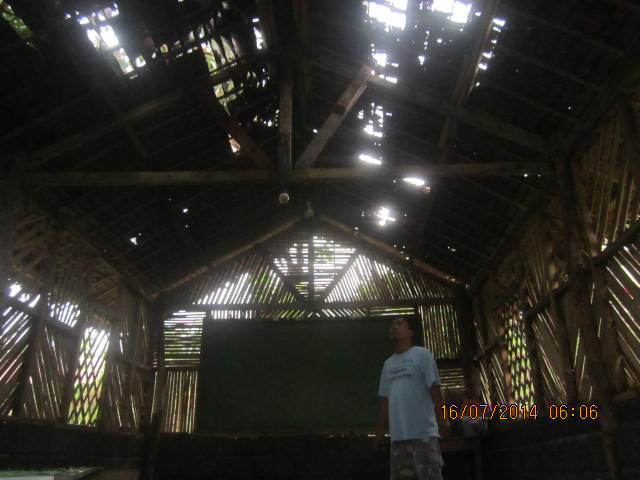 second cottage with holes in nipa roof