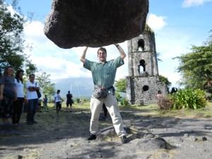Mike lifting heavy load at Cagsawa Ruins at base of Mount Mayon volcano near Legazpi